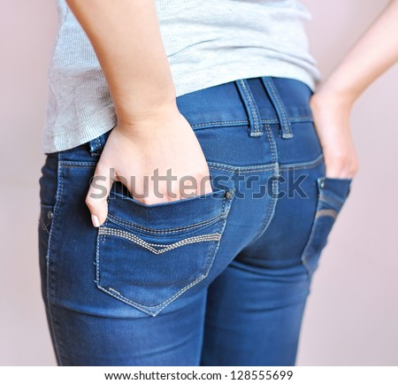Young girl wearing a pair of jean pants - stock photo
