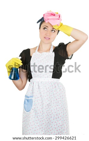 Young girl wearing apron and holding cleaning productswith hand on forehead isolated on white - stock photo