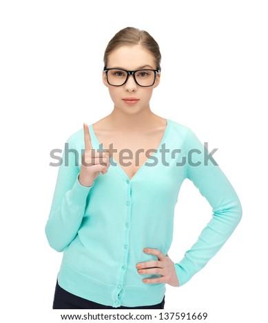 young girl wearing eyeglasses showing warning gesture - stock photo