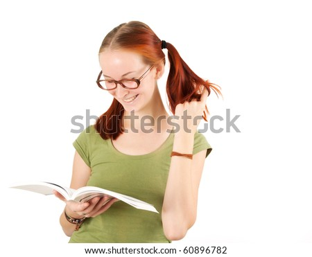 Young girl wearing glasses holding textbook isolated on white. - stock photo