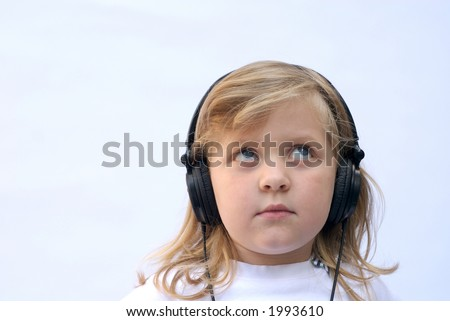 Young girl wearing  headphones