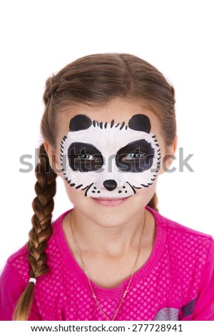 Young girl wearing panda carnival face paint isolated on white - stock photo