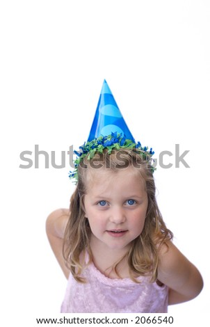 Young girl wearing party hat on white background - stock photo
