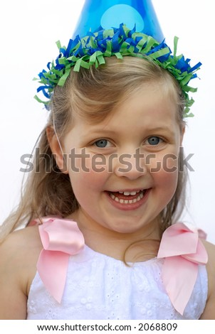 Young girl wearing party hat, smiling - stock photo