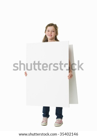 Young girl wearing plain white sandwich board - stock photo