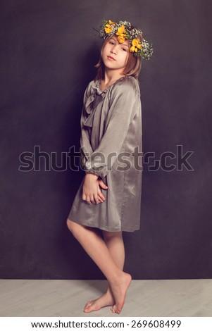 Young girl wearing silk dress - stock photo
