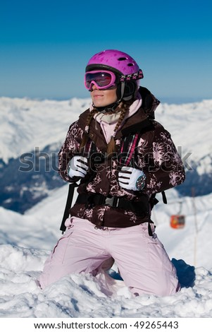 Young girl wearing sport gear on winter vacation - stock photo