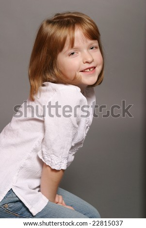 Young girl wearing white shirt