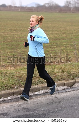 Young girl while training for a competition in winter - stock photo