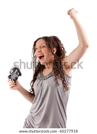 Young girl win a computer game on game console. - stock photo