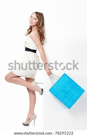 Young girl with a bag of flying on a white background