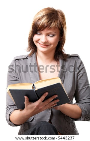 Young girl with a book isolated at the white background - stock photo