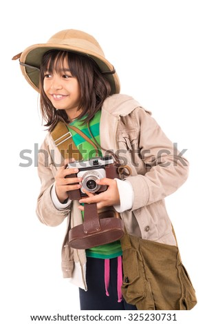 Young girl with a camera playing Safari isolated in white - stock photo