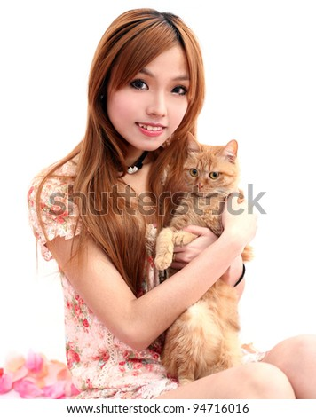 young girl with a cat pet - stock photo