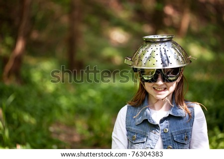 Young girl with a colander safety hat and goggles - stock photo
