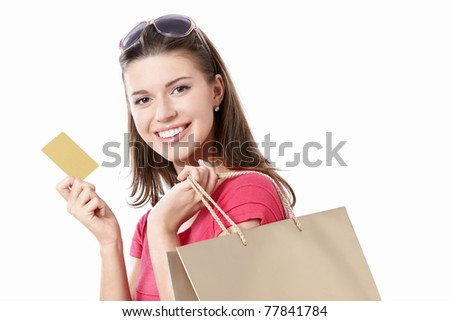Young girl with a credit card and shopping bags isolated - stock photo