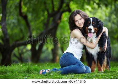 Young girl with a dog in the park - stock photo