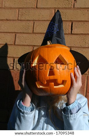 Young girl with a Halloween pumpkin - stock photo