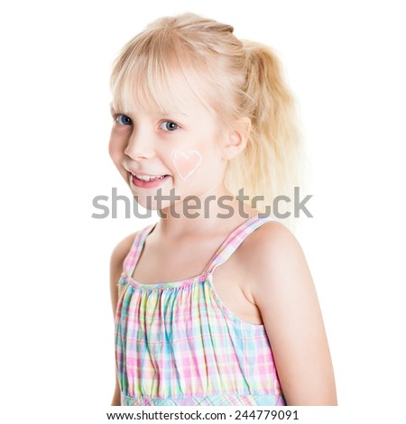 young girl with a heart made of creme on her face on isolated background - stock photo