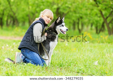 Young girl with a husky puppy.