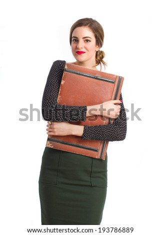 Young girl with a leather wallet - stock photo