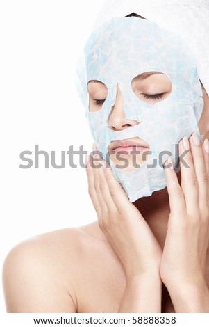 Young girl with a mask on the face of a white background - stock photo