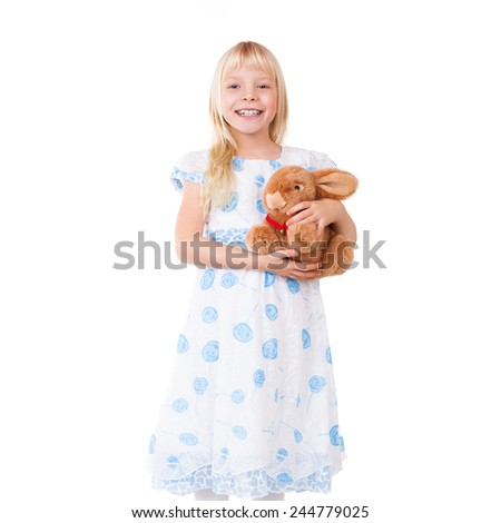young girl with a plush toy - stock photo