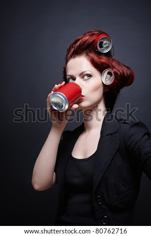 Young girl with a red jar in hand - stock photo