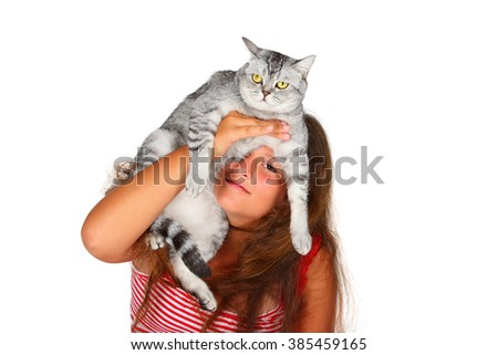 young girl with a scottish cat  - stock photo