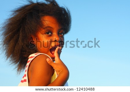 Young girl with a shocked facial expression - stock photo