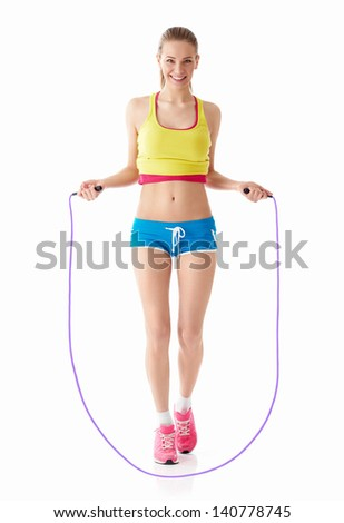 Young girl with a skipping rope - stock photo