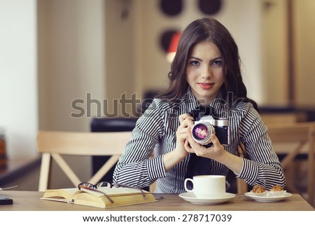young girl with a vintage camera - stock photo