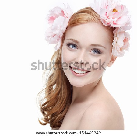 Young girl with a wreath of flowers - stock photo