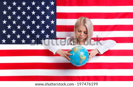 Young girl with American flag and globe - stock photo