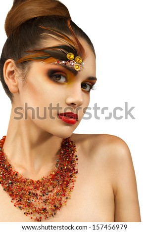 young girl with autumn Visage. ornaments made of feathers.