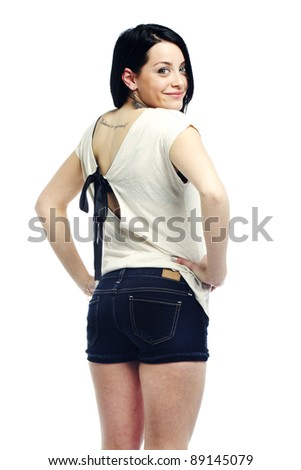 Young girl with back turned smiling against isolated background - stock photo