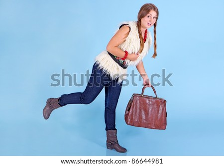 Young girl with bag in jeans full body - stock photo