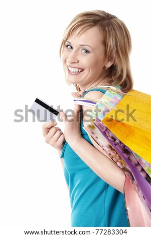Young girl with bags and credit card on a white background - stock photo
