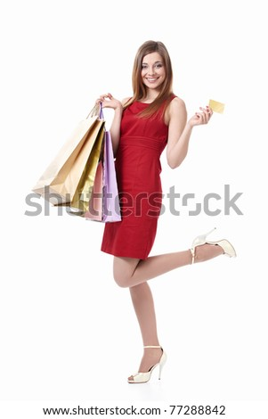 Young girl with bags and credit card on a white background