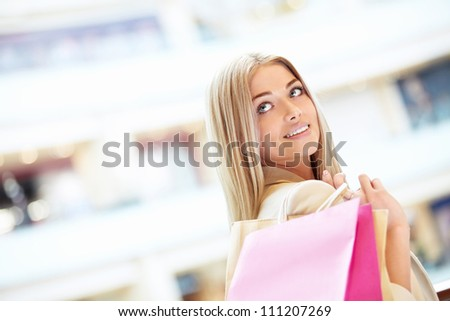 Young girl with bags in the store - stock photo