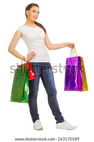 Young girl with bags isolated - stock photo