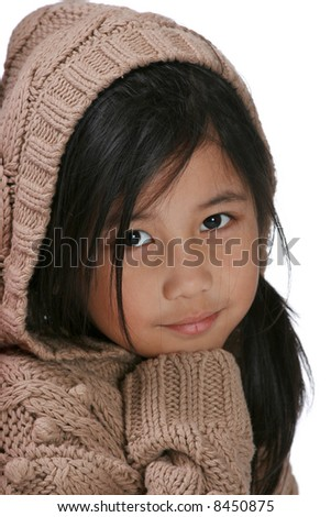 Young girl with beige knit hoodie - stock photo