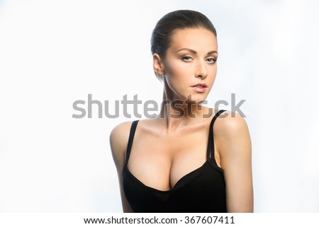 Young girl with big, beautiful breasts - stock photo
