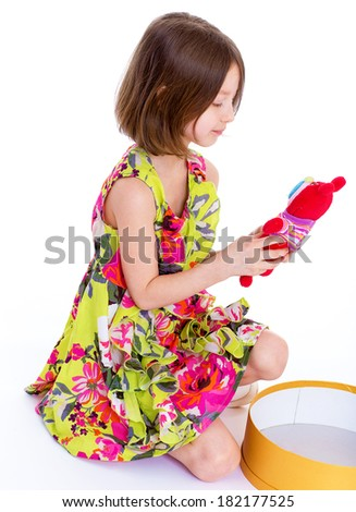 young girl with big round box.Isolated on white background.