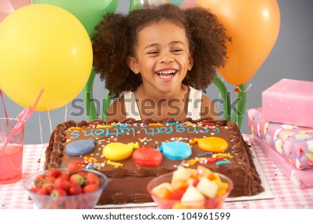 Young girl with birthday cake and gifts at party - stock photo