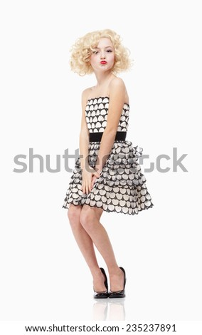 Young Girl with Blond Wig Posing as Marylin Monroe - stock photo