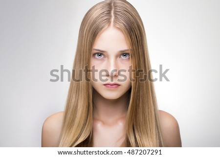 young girl with blonde hair and beautiful eyes