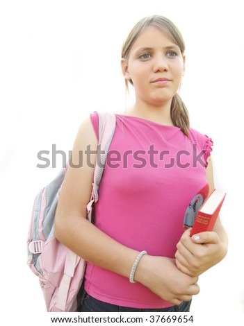 Young girl with book and school bag - stock photo