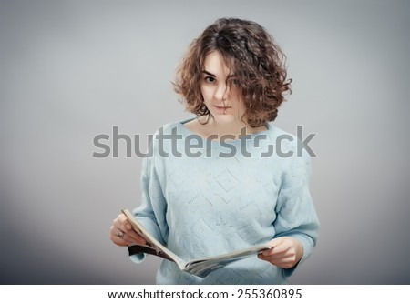 young girl with book isolated  - stock photo