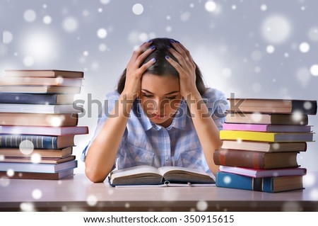 Young girl with books  over snow effect